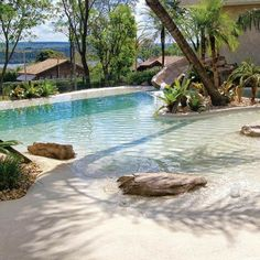 Swimming pools with beach entry design have become more and more popular today. It makes a pool look way more attractive with its unique style. As the name suggests, the beach entry pool will make … Natural Swimming Pools, Swimming Pools Backyard, Swimming Pool Designs, Pool Landscaping, Swimming Hair, Landscaping Design, Beach Entry Pool, Backyard Beach, Backyard Pool Designs