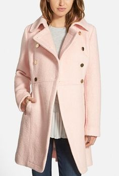 A broad notch collar and double-breasted styling with shiny regimental buttons bring classic military polish to a cozy bouclé coat. Zip pockets and cuffs add a modern edge, while topstitched detailing accentuates the flattering cut.