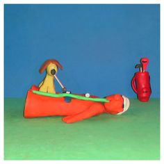 While Bob took a nap, Scooby decided to practice his puttinglooking good on the linenaughty #golf #fun #tips #golfing #golfwang #golflife #bob_scooby #creative #clay #art #artist #artistic #picoftheday #artoftheday #sculpture #polymerclay #dog #cute #artwork #photo #doglover #golftips