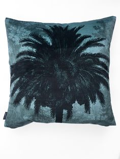 Square 50 x Add a calming statement to your home with this Vanilla Fly Blue Palm Cushion. In a soft blue hue, with a palm tree image, it will
