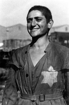 A survivor with a Jewish badge sewn onto his clothing.