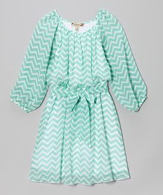 This fun frock is fit for a number of occasions! A classic silhouette keeps it versatile, while a playful zigzag pattern adds pizzazz. Little ladies can slip this dress on easily thanks to an elastic waistline and stay comfy all day in its soft and stretchy fabric. A sash at the waist means a perfectly snug fit every time.