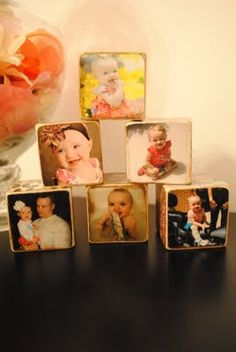 photo blocks.  Hobby Lobby or basically any craft store sells wood blocks.  Use scrapbook paper as desired and then just Modge Podge the paper and pictures to the blocks.  Then sand the edges and add some distressing ink (Hobby Lobby scrapbooking/stamps aisle) to the sanded edges to make them look old. Definitely gonna do this for my momma :)