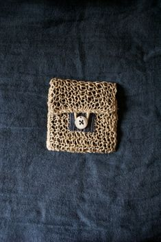 baby pouch purse hand knitted in linen twine indigo by bluesamovar