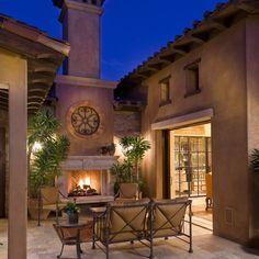Outdoor stucco tuscan fireplace