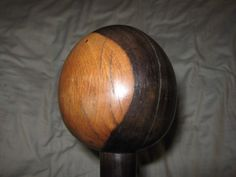 For sale is a Zulu Knobkerrie Made from Lignum Vitea Single piece construction,Nice shape to the handle The total length is 33 , Head is 3 Across,3.5 Tall ying yang two tone colour (see pic)