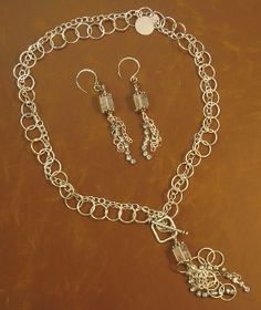 """All That Jazz! 18"""" sterling silver chain and rhinestone chain with a front toggle closure and square quartz crystal dangle accent. Necklace & Earrings $115  #cassandramillardjewelry #sterlingsilver #oneofakind #handmade #rhinestone #quartzcrystal"""
