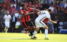 Jordan Ibe of AFC Bournemouth is tackled by Daley Blind of Manchester United…