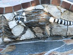 raccoon stone mural by Pierson Masonry