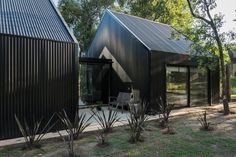 The house is composed of three separate modules. Tagged: Exterior, Metal Siding Material, Gable RoofLine, House Building Type, and Metal Roof Material. Photo 5 of 12 in This Barn-Like Home Is Closed to the Street and Open to the Forest. Black House Exterior, Exterior Siding, Modern Exterior, Exterior Design, Building Exterior, Black Metal Roof, Metal Barn, Gable House, Modern Barn House