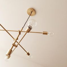 """The #westelm Mobile Chandelier looking brassy and classy in our recently completed DUO!"""