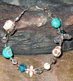 $25 Guitar String Bracelet!  www.facebook.com/skullsandstones