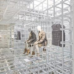 Clothes and accessories are ensconced in an elaborate lattice of wood at an Amsterdam boutique designed by Dutch studio Doepel Strijkers.