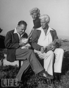 Author W. Somerset Maugham (L) sitting w. poet Max Eastman (R) & his wife, painter Eliena Eastman & their two Persian cats during Maugham's summer on Cape Cod.  In this photo: Somerset Maugham, Max Eastman, Eliena Eastman  Photo: Alfred Eisenstaedt/Time & Life Pictures/Getty Images  Jan 01, 1944