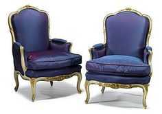 Louis XV style white painted and parcel gilt bergeres   19th century   The straight shaped and carved frames enclosing padded backs issuing part-upholstered scrolling enclosed arms, above loose cushion seats and foliate and flower carved seat rails, raised on carved cabriole legs; covered in blue silk.
