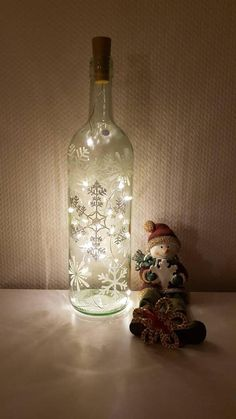 bottle lightbottle chain of light meditation lotus flower tranquillity serenity Painted Wine Bottles, Lighted Wine Bottles, Bottle Lights, Wine Bottle Crafts, Bottle Art, Fall Crafts, Christmas Crafts, Xmas, Diy Craft Projects