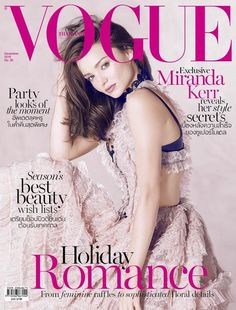 Australian TopModel Miranda Kerr graces the December 2015 cover of Vogue Thailand, looking pretty in pink wearing a ruffled frock designed by Alexander McQueen. Captured by Russell James, Miranda looks super romantic in the image