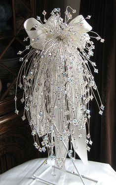 Swarovski Crystal cascading bridal bouquet. 250 stems. Handmade at Jolly Fine Jewellery.