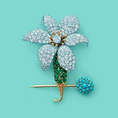 Tiffany & Co. Schlumberger® Orchid clip of platinum and 18k gold with 241 diamonds and 35 emeralds, which includes a removable pin with turquoise. #TiffanyPinterest