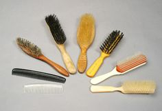 249: MARILYN MONROE HAIR BRUSHES AND COMBS : Lot 249 A group of six plastic and wood hairbrushes and two plastic combs. Also present are two Christie's tags as these items were originally intended to be sold there in 1999.
