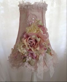 Like this pretty lamp shade idea - love the combination of artificial flowers, lace and ribbons! :)