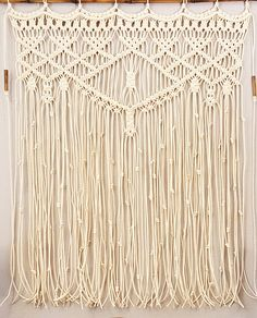 Large Macramé Wall Hanging, Window Treatment, Headboard Size: Macramé hanging measures approximately 33-34 wide and 43 long (Convo for your special measurements). Un-mounted with loops for your rod. ►This listing is WITHOUT the bamboo rod. If you would like the macramé attached to the