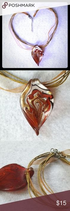 """Lovely Glass Pendant Beautiful boutique red and gold swirl glass pendant with black accents in reverse teardrop with a twist design. 16"""" gold cord and ribbon choker with lobster clasp and 1.5"""" extender. Pendant is about 2.25"""" long and 1.25"""" wide. Excellent used condition. Jewelry Necklaces"""