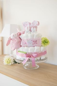 Super Cute Baby Bunny Nappy Cake. Packed full of baby products. Perfect Gift & Baby Shower Centrepiece. Baby Girl Collection www.nappycakesbybetty.com