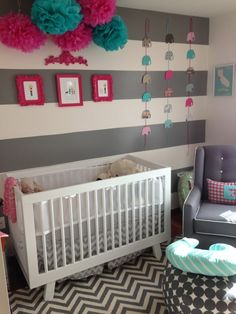 This bold gray nursery features a mix of pattern and color!
