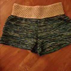 Missoni like pattern shorts with crochet waist Short aqua/green/blue shorts with beige crochet top. These shorts are sheer but you can't see thru them. They are short but cute for summer over bikini or with sandals and tank. NWT. Size M but these run small. I always wear a small. élan  Other