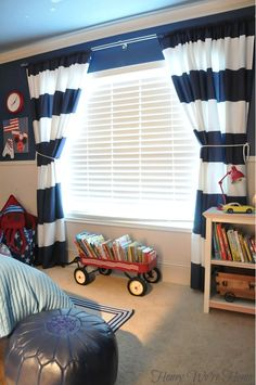 Like the way the curtains frame the window, makes a good impression for a kids room.