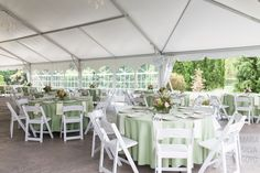 Pale green, white and pink reception tables under the tent for a wedding reception at the Cornwall Inn