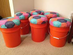 Stools for guided reading table. 5 gallon buckets and lids from Home Depot. Mattress pad, fabric and staple gun, done.