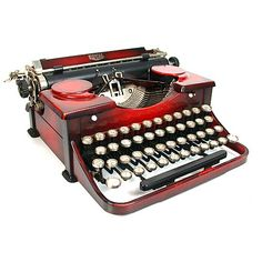 Vintage 1930's Red Duo-tone Royal Typewriter in a graduated red enamel finish. This machine is a wonderful example of Art Deco industrial design.