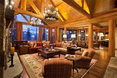 Telluride, Colo.  After a long day of hitting the slopes, guests will gladly sit back and relax in this warm and inviting living room. Soaring ceilings, glittering chandeliers and a commanding fireplace create the perfect [more]
