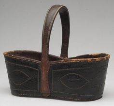 "S.S. Cottrell & Co. - Key Basket. Stitched Leather. Stamped on Bottom ""S.S. COTTRELL & CO. / RICHMOND, VA."". Richmond, Virginia. Circa 1850-1887. 6-3/4"" x 8-7/8"" x 3-1/8""."