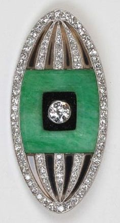 An Art Deco 'Melon' brooch, by Lacloche, circa 1930. The brooch set with jade, onyx and diamonds, mounted in platinum. Signed. #Lacloche #ArtDeco #brooch