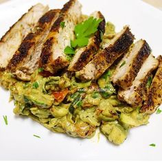 ✨Grilled chicken with Zucchini noodles in an avocado and basil sauce✨  By @oh_my_foodness  Sauce:  2 avocados, pitted  1 garlic clove, minced Half lemon juice Handful fresh basil 1 tbs olive oil Salt and pepper  Noodles & Chicken  2 large zucchini, spiralized Salt and pepper 1 tbs olive oil 1 tsp dried oregano 1 tsp dried basil  Chicken breast seasoned Handful grape tomatoes, halved For the sauce, add all ingredients into a food processor until smooth. Season chicken and cook on pan with a…