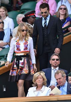 Suki Waterhouse and Bradley Cooper attend the semi-final match between  Noval Djokovic and Grigor Dimitrov on centre court at The Wimbledon  Championships at ... b6eb75396d