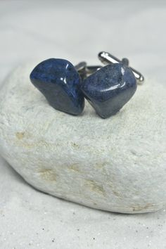Handmade custom tumbled dumortierite stone cufflinks. The silver cufflinks are made with green dumortierite stones, that have wonderful vibrant coloring. The cuff links are hand made in the USA. It comes from a smoke free environment. The green dumortierite cufflinks measure:  23 mm x 16 mm x 7 mm  or .9 inches x .63 inches x .29 inches.  Please note: These are not identical. While the stones are selected due to their similar shape, color and texture there are some minor differences, that…