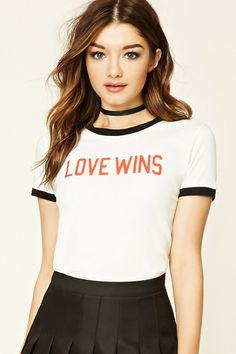 """A knit ringer tee featuring a """"Love Wins"""" graphic on the front, contrast trim, and short sleeves."""