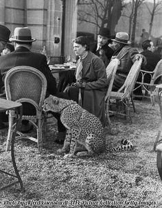 Woman and cheetah at Bois de Boulogne Cafe, Paris, 1932.
