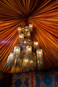 A stunning chandelier made for royalty at this wedding reception inspired by Disney's Aladdin