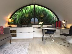Stunning garden room utilized as a home office.