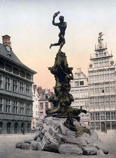 """Brabo fountain by Jef Lambeaux, Antwerp, Belgium 'This photochrome print of the Brabo Monument in Antwerp is part of """"Views of Architecture and Other Sites in Belgium"""" from the catalog of the Detroit. Places Around The World, The Places Youll Go, Great Places, Places To See, Beautiful Places, Around The Worlds, Bruges, Antwerp Belgium, Jolie Photo"""