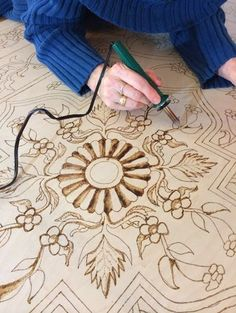 Detail of pyrographic art table top
