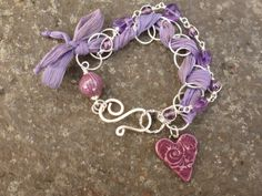 Multistrand bracelet with a ceramic heart  by BewitchedHandcrafted, £30.00