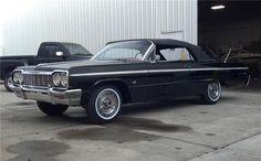 1964 BLACK CHEVROLET IMPALA SS.  A true Classic.