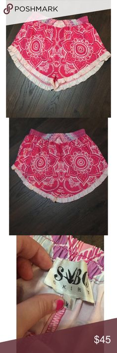 Sabo skirt shorts 🖊D e s c r i p t i o n 🖊 These shorts are colorful and fun for anyone. They are pink and white with a elastic too and ruffled bottom.   ⚫️C o n t e n t⚫️ 100% polyester   ✂️M e a s u r e m e n t s ✂️ Size medium   🔘C o n d i t i o n 🔘 New without tags   👖👚P a i r W i t h 👚👖 A basic pink or white top and sandals   🚫 No trades 💕 Reasonable offers welcome  💰 Bundle discount offered  📬 Ships in 1-2 Sabo Skirt Shorts