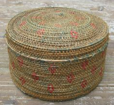 Alaskan lidded treasure basket, single rod coiling, sewn with red and faded green beach grass in geometric designs on willow rod